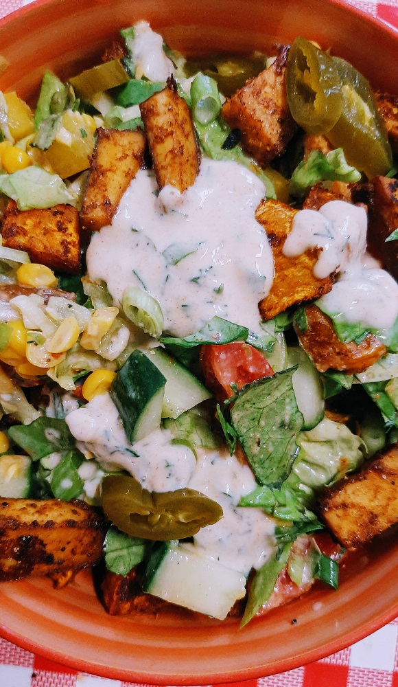 Sweet potato, smoked tofu and corn vegan salad